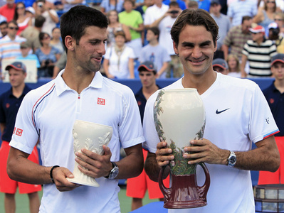 Roger Federer beats Novak Djokovic to win a record fifth title in